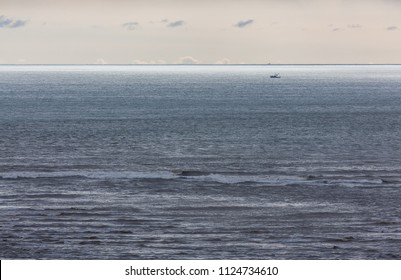 A small fishing boat out in the big Pacific ocean off of the southern cost of Costa Rica, Central America.