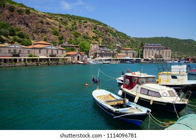 Small fishing boats anchored in the marina of Behramkale Assos, Turkey