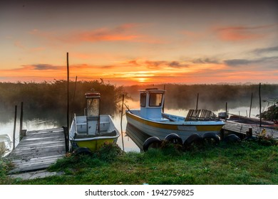 Small fishing boats in small dock on Zalew Wislany in Katy Rybackie