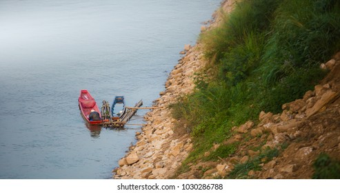 Small fishing boats parked along the Mekong River, Chiang Khan, Loei, Thailand.