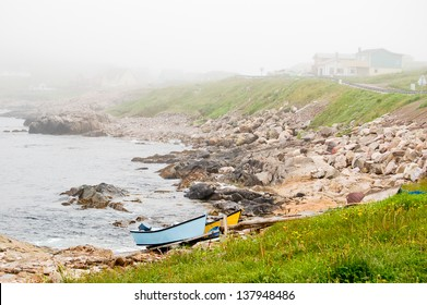 Small fishing boats are pulled up to the rocky coast just outside of St Pierre city.