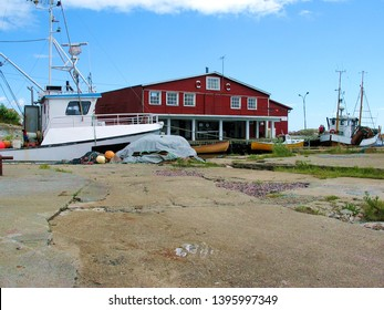 Small fishing harbor in Scandinavia, summer scene in Southern Norway around 'midsommar' (midummer).