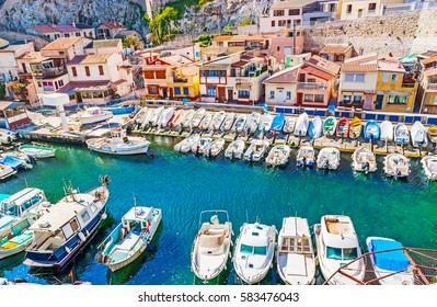 The small fishing haven, full of boats, surrounded by colorful scenic houses, Vallon des Auffes, Marseille, France.