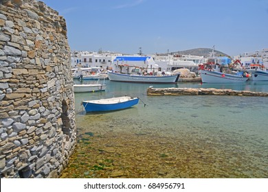 Small fishing port on a greek island in the Cyclades Group, with stone fortress guarding the harbour