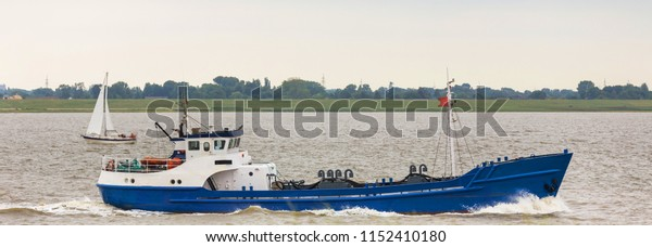 small fishing ship on an river