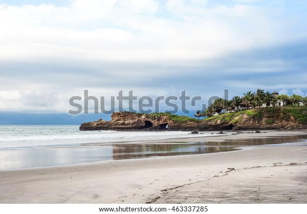 Small fishing village of Mompiche is located in the northern Ecuadorian Pacific coastline, perfect surfing setting with thickly forested hills dropping down to a wide beach backed by palm trees