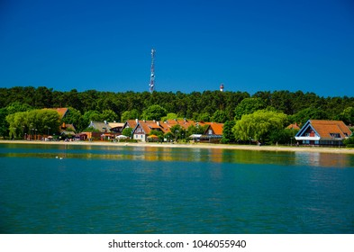 Small fishing village Nida with traditional houses on the shore of lagoon in National Park Kursiu nerija, the Curonian Spit, Baltic sea, Lithuania