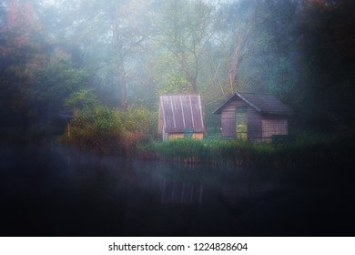 Small fishsing huts on the shore of beautiful green lake