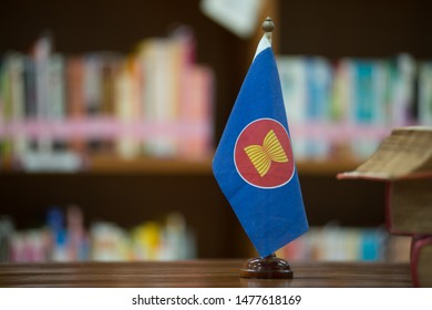 A small flag, the symbol of the ASEAN logo on the desk