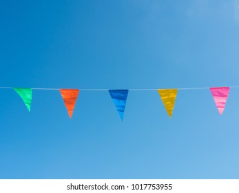small flags with blue sky and cloud