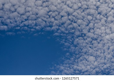 small fleecy clouds in the sky in summer