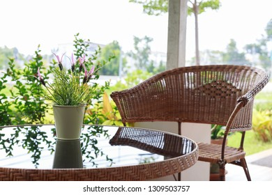 small flower vase decor on black glass table
