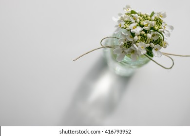 Small Flowers In Glass Vase With Bow Tied On It Viewed From Above