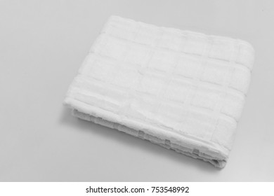 Small folded towels isolated on white background.  Squared pattern hand towel for multipurpose cleaning.
