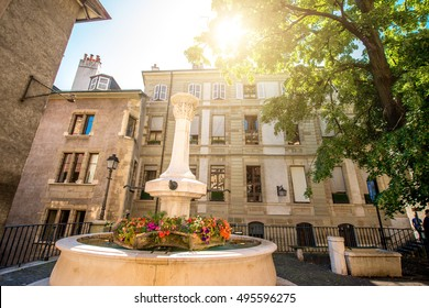 Small fountain in the old town of Geneva city in Switzerland