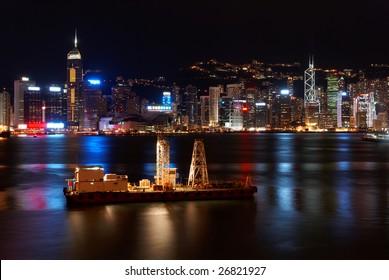 Small freight ship in Hong Kong at night