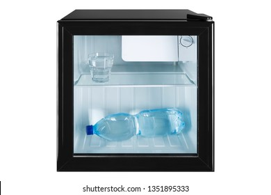 small fridge bar with a transparent glass door, inside the bottle and a glass full of water, the concept of summer and cooling, frontal arrangement
