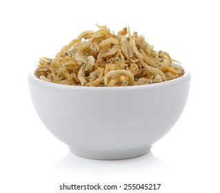 small fried fish in the bowl on white background