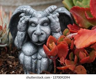 Small garden gargoyle statue