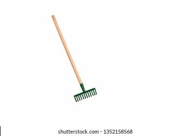Small gardening rake isolated on white background