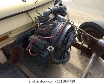 Small gasoline carburetor engine of a car an unusual construction.