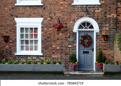 Small Georgian town house exterior, decorated for Christmas, East Yorkshire, UK