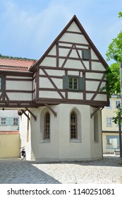 Small German half timbered house in medieval town with cobbled streets