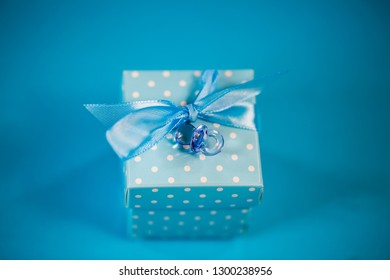small gift in blue wrapping, newborn, birthday