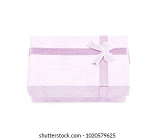 Small gift box with a ribbon bow isolated over the white background