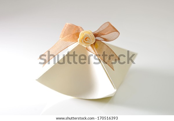Small gift in a decorative paper packaging.