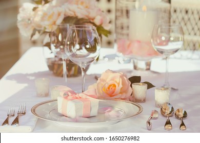 Small gift with pink ribbon on table