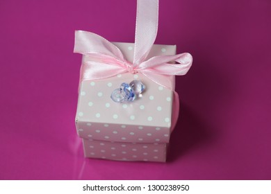 small gift in pink wrapping, newborn, birthday