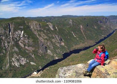 Small girl admiring the landscape of Malbaie Canyon and river from the summit of Acropoles des Draveures, Hautes-Gorges-de-la-Rivière-Malbaie National Park in Quebec, Canada