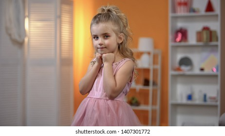 Small girl in beautiful dress posing for camera, making birthday photosession