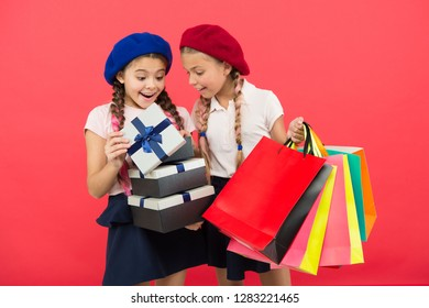 small girl children with shopping bags. friendship and sisterhood. Birthday and christmas presents. International childrens day. big sale in shopping mall. Happy shopping online. Successful shopping.