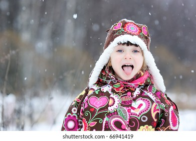 Small girl in colorful snowsiut