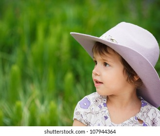 Small girl in a cowboy hat outdoor