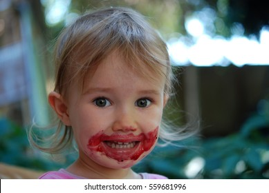 Small Girl eating jam