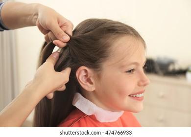 Small girl in hairdressing salon