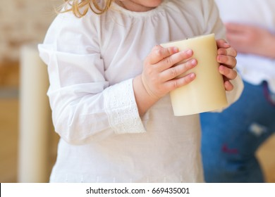 small girl holding a candle