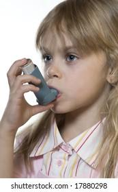Small girl inhaling a medicine