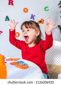The small girl in kindergarten