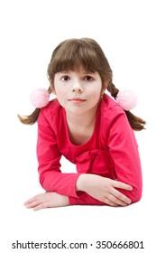 A small girl is lying on floor in studio
