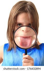 small girl and magnify glass