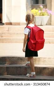 Small girl near school