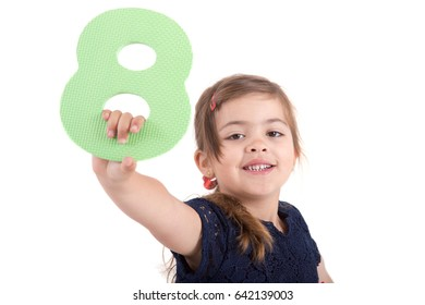 small girl with number eight over white background