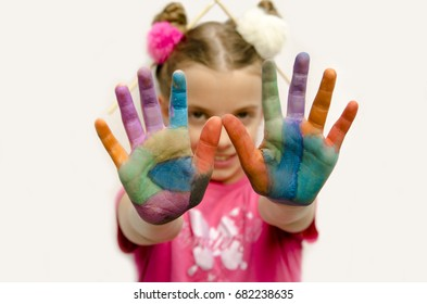 Small girl painted palm hand close up. Child girl show her hands. Selective focus. Have fun. Creative colorful art concept . Child's day