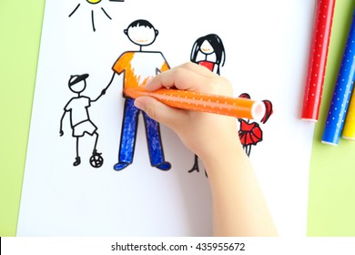 Small girl painting on cute picture