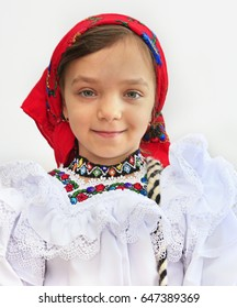 Small girl portrait wearing romanian traditional clothes from Maramures area