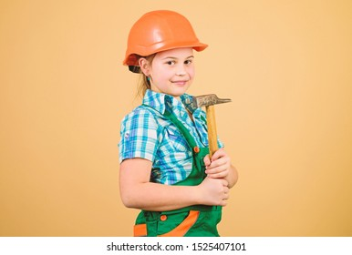 small girl repairing with hammer in workshop. Tools to improve yourself. Repair. Child care development. Future profession. Builder engineer architect. Kid worker in hard hat. working in repair shop.